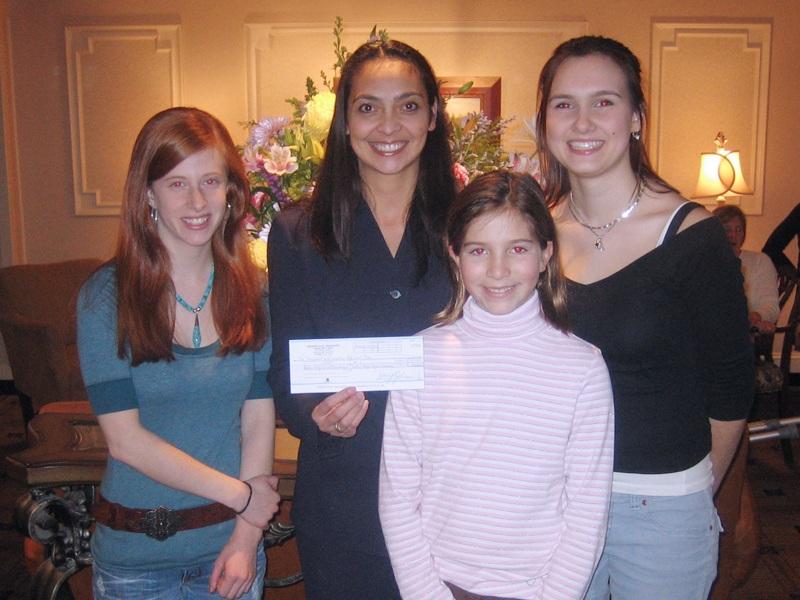 Anita Sayers, Director of Marketing and PR for The Radnor Hotel presenting The Radnor's donation check to friends of Megan Hayes: Shanna Wagenheim, Sveta McShayne and Celia Parkin. January 2006.