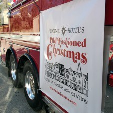 Old Fashioned Christmas Banner on firetruck