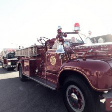 Old Fashioned firetruck driving in the parade