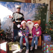 Staff Sergeant and daughters with Santa