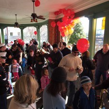 Families waiting on the Veranda of the Wayne Hotel to see Santa