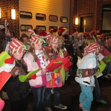 Young carolers in front of Radnor firehouse