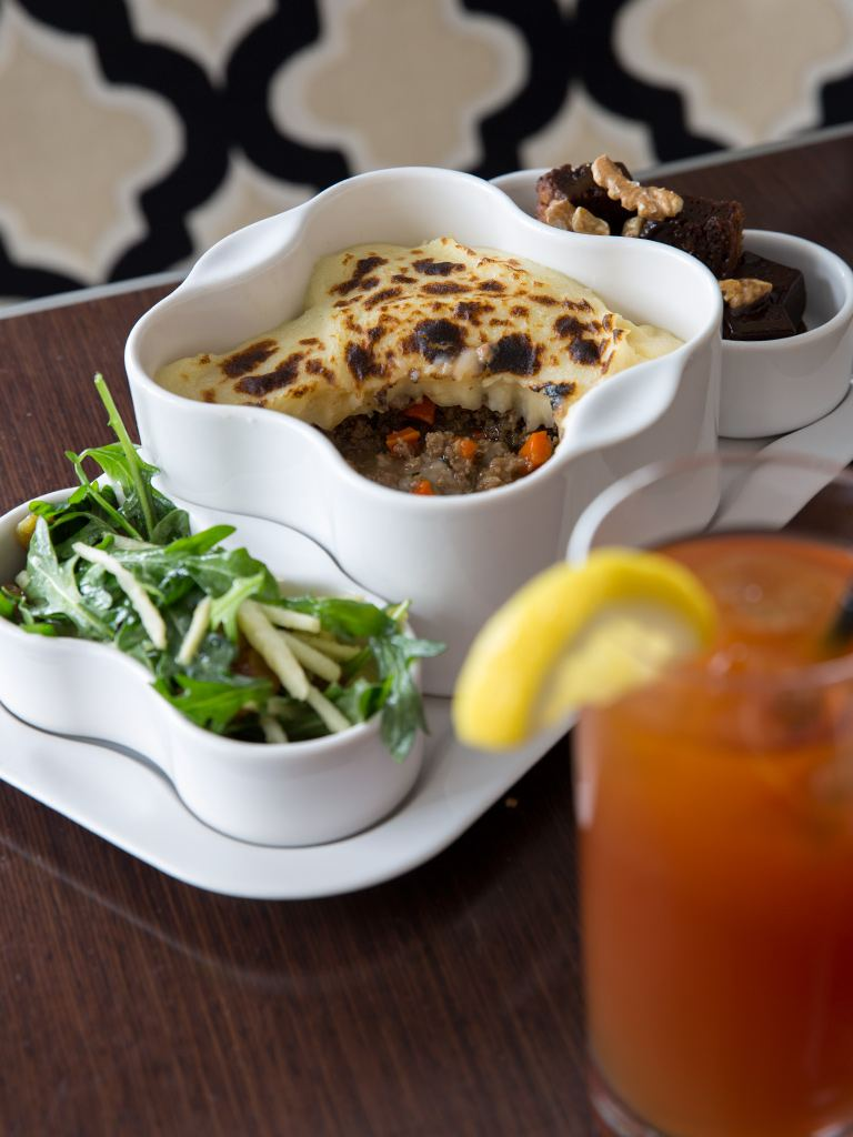 Shepherd's Pie with lamb, onion, carrot, celery root, parsnip and garlic topped with Yukon gold whipped potatoes