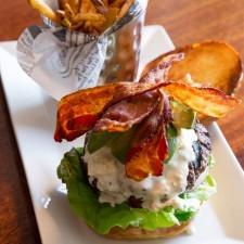 The Cali-Cobb Burger, Blue Cheese, Bacon, Lettuce, Tomato, Red Onion, Avocado, Brioche Roll