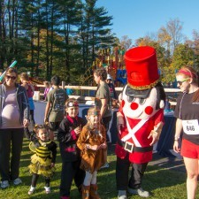 The Radnor Hotel's Toy Soldier and Holly Allen (The Radnor Hotel) leading the Halloween Parade