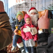 Families gather on the Wayne Hotel's Veranda to meet Santa at Wayne Hotel's Old Fashioned Christmas