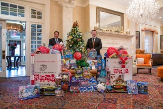 Joseph Amrani, General Manager of Paramour, and David Brennan, General Manager of the Wayne Hotel, in the Lobby Lounge with the generous donations for Toys for Tots.