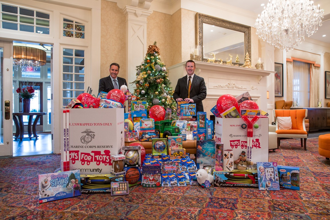 Joseph Amrani, General Manager of Paramour, and David Brennan, General Manager of the Wayne Hotel, are pictured in the Lobby Lounge with the generous donations so far for Toys for Tots.