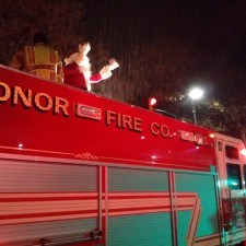 Old Saint Nick drove by on a fire truck just moments before the Tree Lighting Ceremony