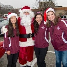 Santa greeted the Radnor High School Parade participants with Christmas spirit