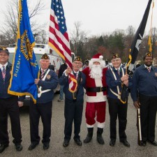 Santa greeted the Color Guard of the American Legion Bateman-Gallagher Post 668 of Wayne before the Parade