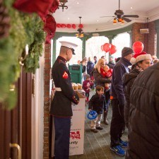 Little ones lined up on the Veranda at the Wayne Hotel to meet Santa following the Parade