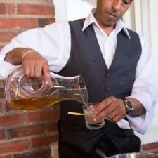 Joseph De Lasalle (Paramour Server) pours Mint Juleps for Derby Guests