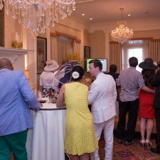Derby Party guests gather around the TV in the Lobby Lounge