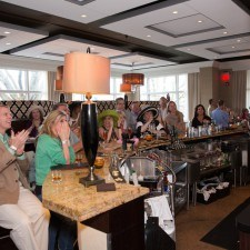 Derby Party guests gather in the Bistro Bar to watch the race