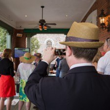 Derby Party guests watching the race on the Veranda