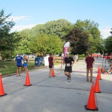 Team member, Alex Neeb, was the first runner to cross the finish line in under 20 minutes