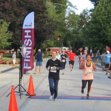 Team member, Anna Guseva, effortlessly crossing the finish line