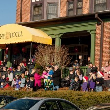 Families gathered at Wayne Hotel's Veranda to meet Santa following the Parade