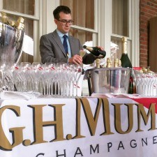 Steven Gullo (Paramour Sommelier & Beverage Director) prepares the beverage table with plenty of G. H. Mumm Champagne, Mint Juleps, and wines by glass