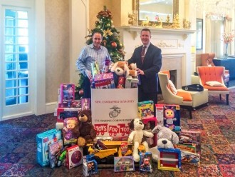 Joseph Amrani, General Manager of Paramour, and David Brennan, General Manager of the Wayne Hotel, are pictured in the Lobby Lounge with the generous donations for Toys for Tots so far.