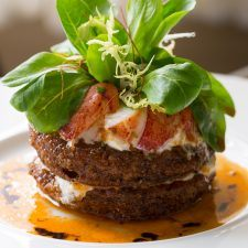 Claudio's Burrata & Lobster piled atop fried green tomatoes, with mâche salad and 25 year aged balsamic