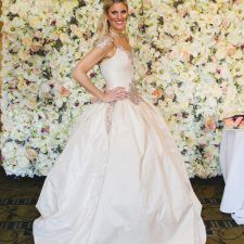 A Van Cleve Bride in front of the Flower Wall by Nicol Floral Designs