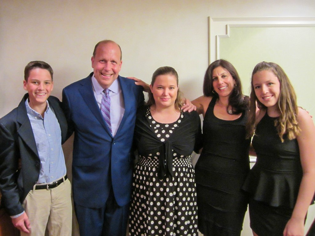 Michelle Coyle, Sales Manager of The Radnor Hotel (center,) with Senator Leach and his family.