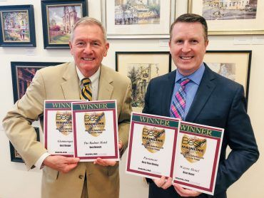 Louis Prevost, Senior Vice President & General Manager of The Radnor Hotel, and David Brennan, General Manager of the Wayne Hotel, accept the Main Line Media News Readers' Choice Awards for The Radnor Hotel, Glenmorgan Bar & Grill, Wayne Hotel, and Paramour.