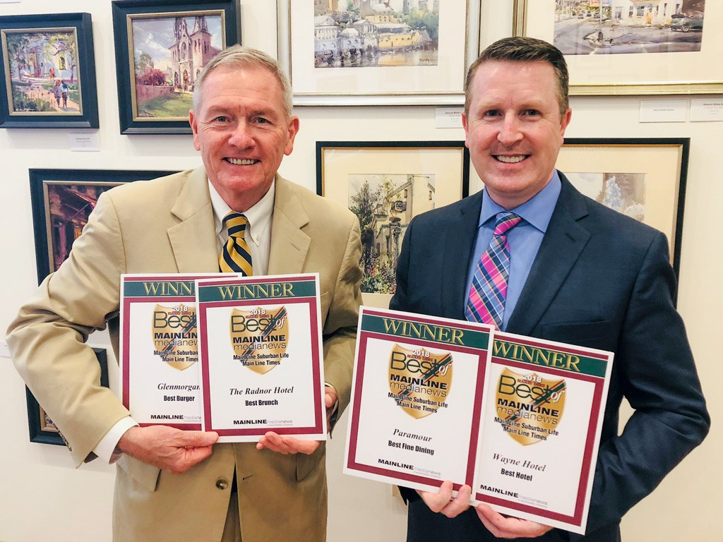 Louis Prevost, Senior Vice President & General Manager of The Radnor Hotel, and David Brennan, General Manager of the Wayne Hotel, accept the Main Line Media News Readers' Choice Awards for The Radnor Hotel, Glenmorgan Bar & Grill, Wayne Hotel, and Paramour at the reception on Wednesday, June 13, 2018.